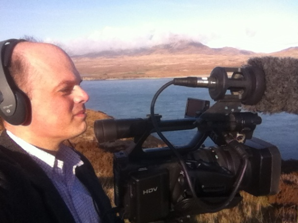 Filming for the BBC on the Isle of Islay looking across to the Isle of Jura (Inner Hebrides, Scotland)