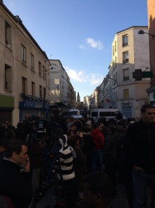Close to the flat that was raided in Saint-Denis a crowd gathered